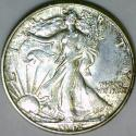 1942 Walking Liberty Half Dollar; Choice AU-Unc.; Lightly Toned.